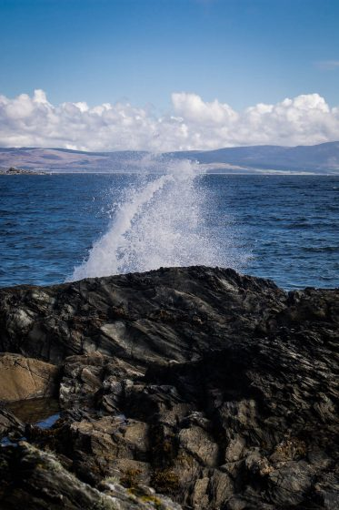A wave crashing into the air at Torrisdale bay in Kintyre