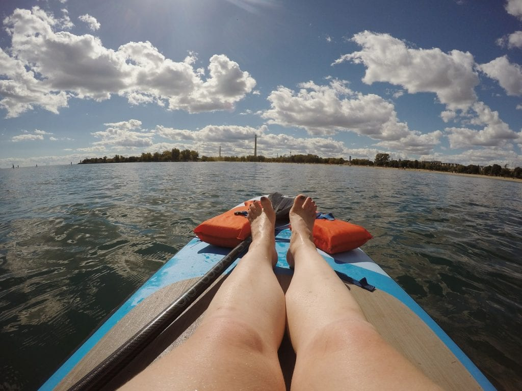 Stand up paddling at Woodbine Beach in Toronto