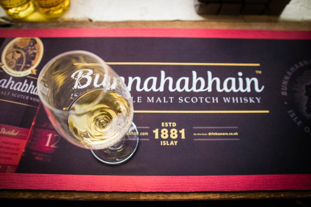 A glass of Bunnahabhain whisky.