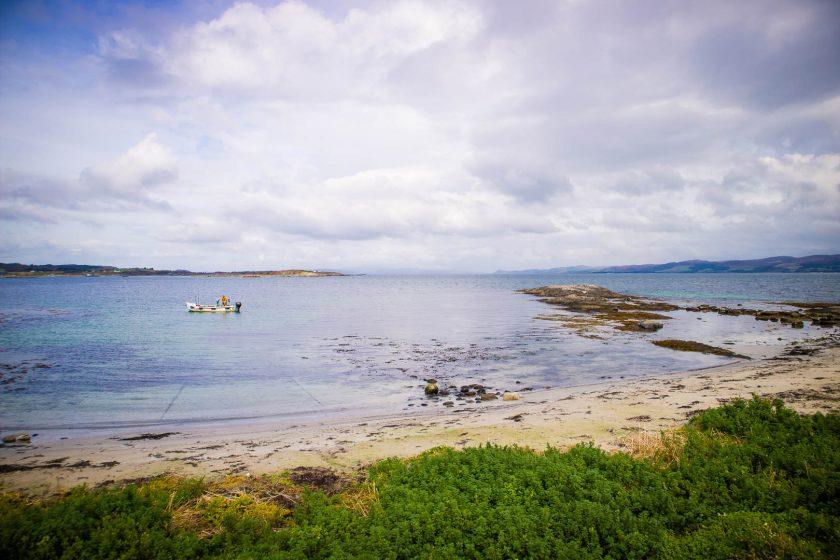 Beach on Cara island near the Isle of Gigha, Scotland