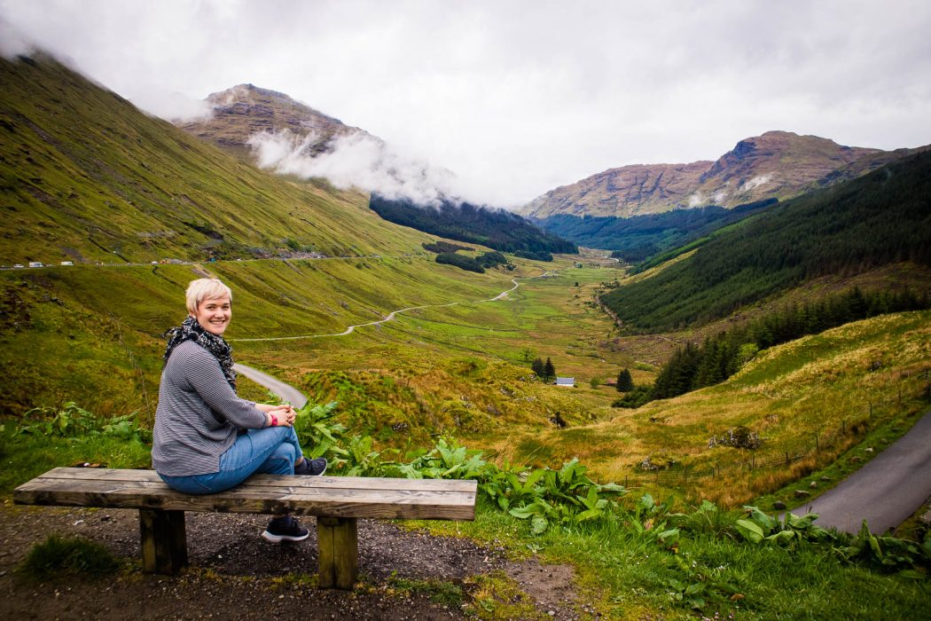 A woman sitting on a bench in Scotland