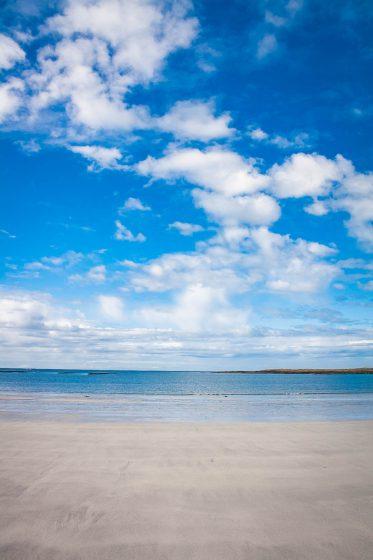 sandy beach and blue sky on oransay