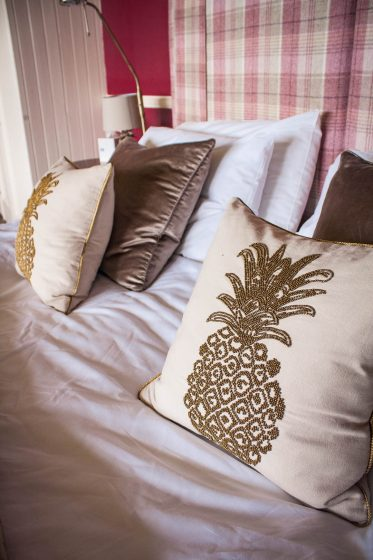 pillows on the bed in the deluxe suite of Loch Melfort Hotel in Scotland