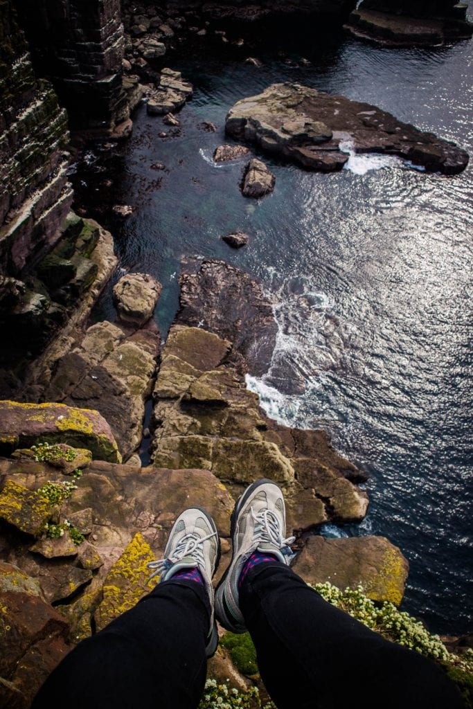 North Coast 500: Dangling feet over a cliff