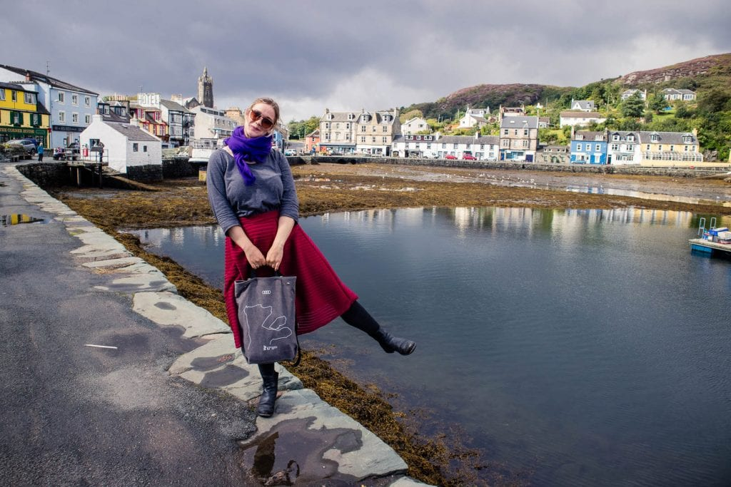 Travel writer Kathi Kamleitner on a road trip through Scotland, wearing a nice outfit with shoes that still allow her to walk on unpaved roads.