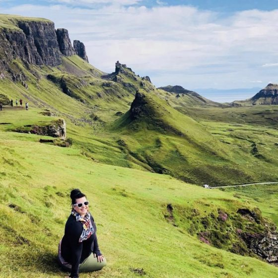 Author Sara Bublitz - A woman sitting in the mountains in Scotland