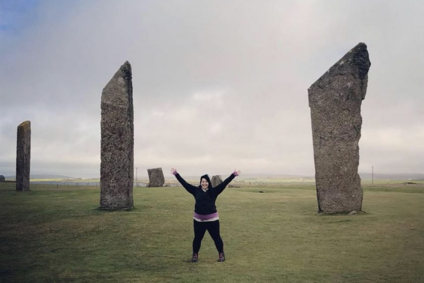 Author Sara Bublitz - A woman standing by standing stones in Scotland