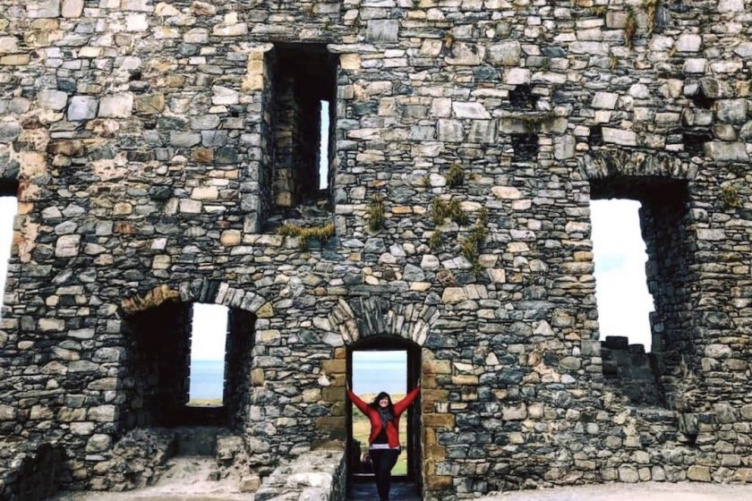 Author Sara Bublitz - A woman standing in the doorway of a ruin in Scotland
