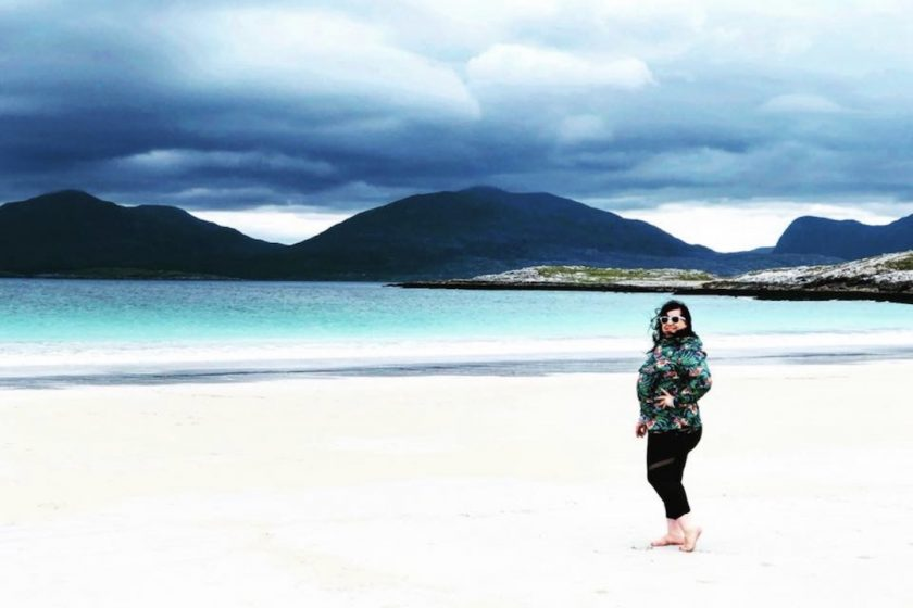 Author Sara Bublitz - A woman standing on a beach in Scotland