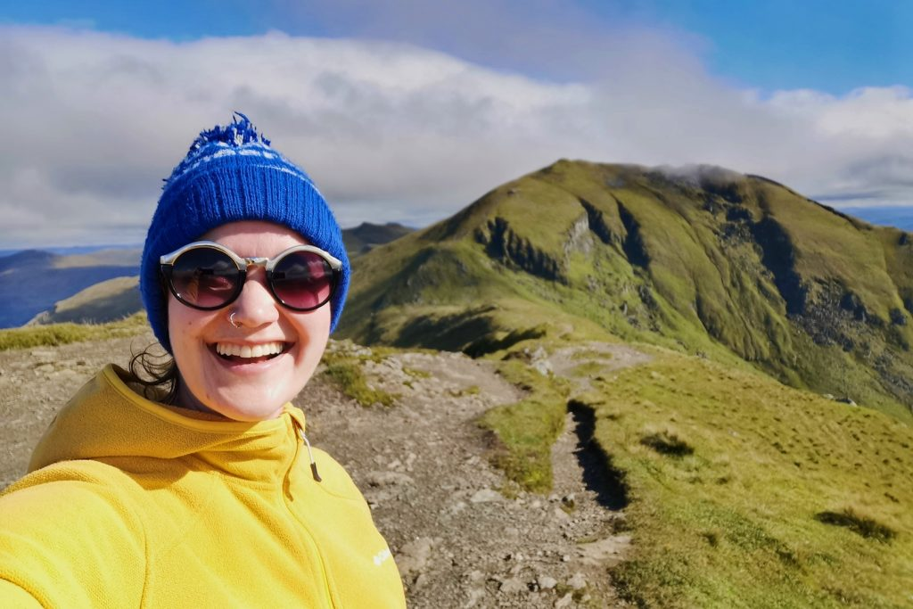 Selfie with the summit of Ben Lawers in the background.