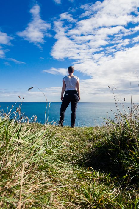 A woman standing at the cliffs of Bullers of Buchan in Aberdeenshire