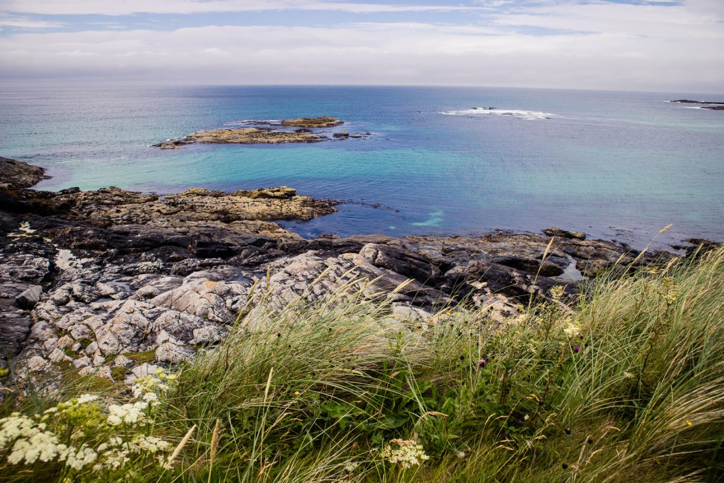 Blue sea on the Isle of Barra in Scotland