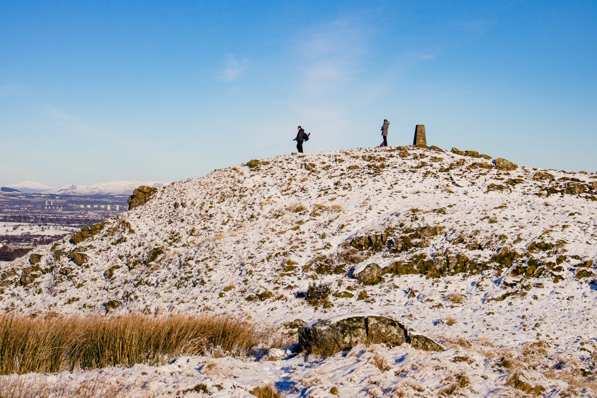 Two hikers at the top of Duncarnock Fort Hike in Glasgow