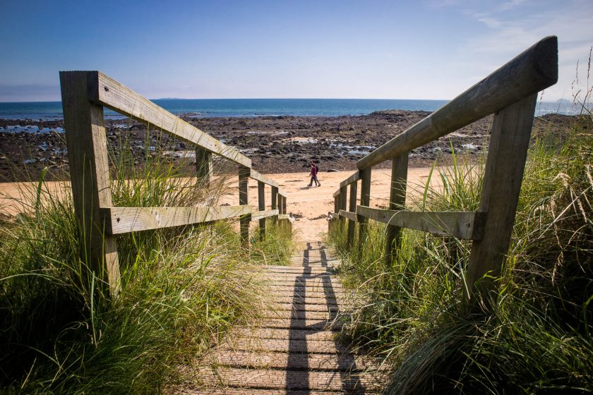 Wooden staircase and sandy beach on the Fife Coastal Path in Scotland