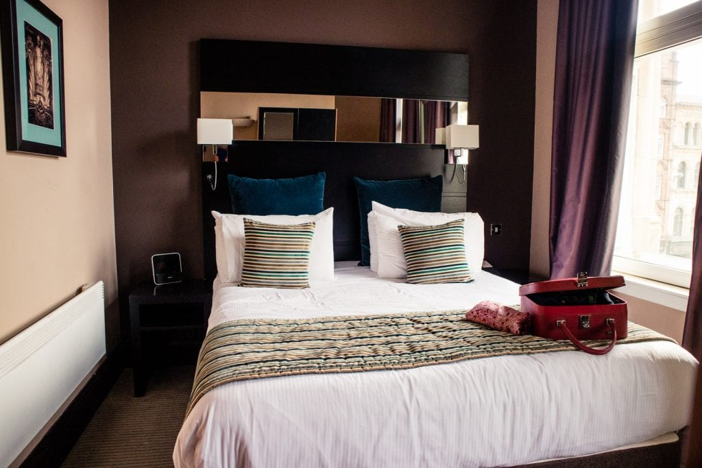 A big double bed in a one-bedroom apartment at Fraser Suites Glasgow.