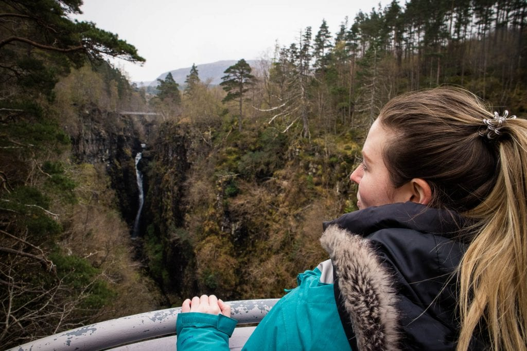 North Coast 500: A woman overlooking Corrieshalloch Gorge