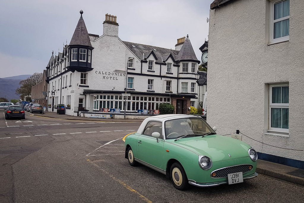 Vintage car and pretty buildings in Ullapool