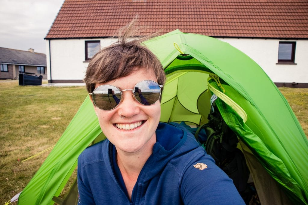 Girl in front of her tent on the Shell Bay campsite on Benbecula.