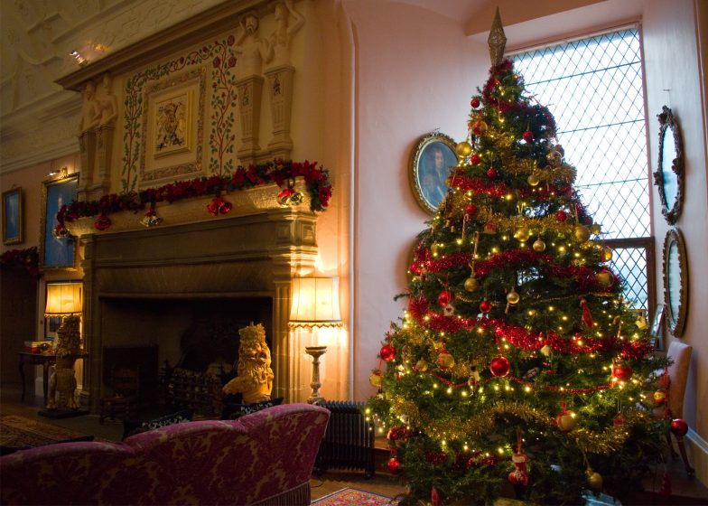 Decorated Christmas tree near the fireplace at Glamis Castle