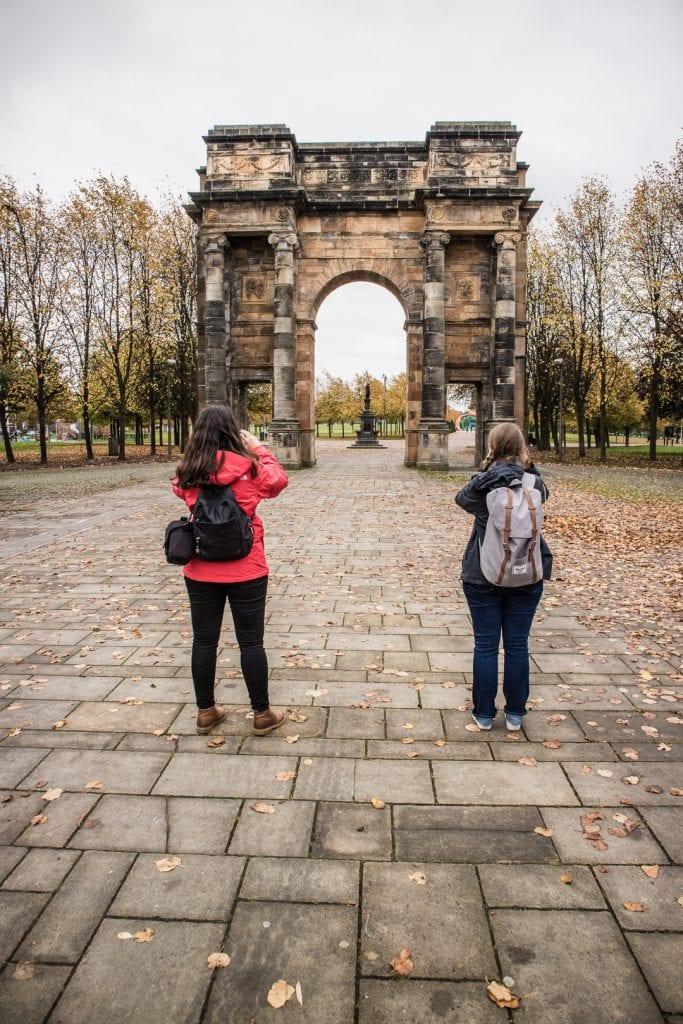 Two women on my Glasgow Walking Tour at the entrance to Glasgow Green park.