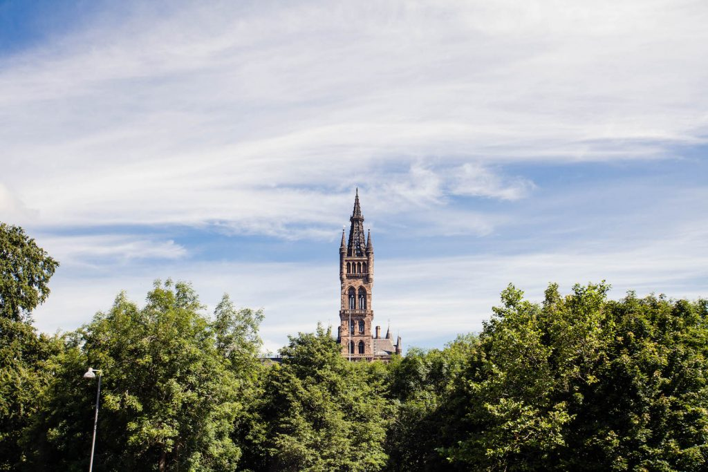 Bell tower of Glasgow University peeking out above the trees