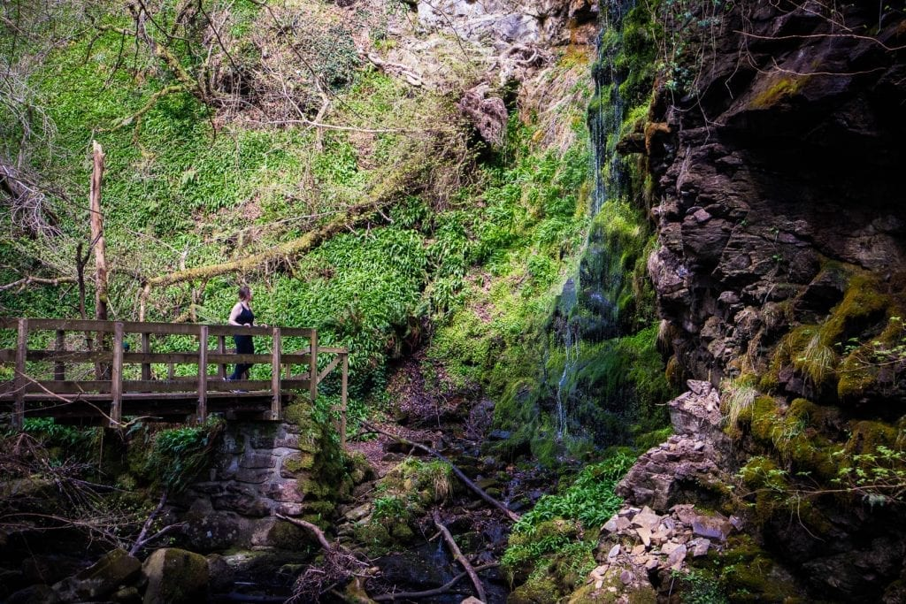 North Coast 500: A woman at a waterfall near Golspie