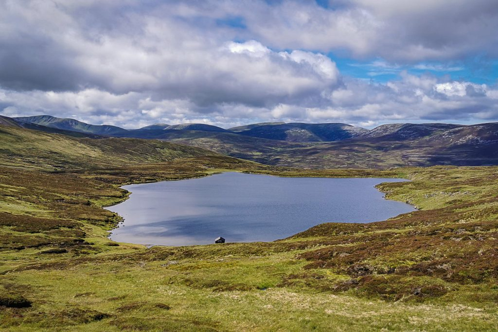 View of a loch in the Cairngorm mountains from the Cairnwell Munros, three great Munros for beginners.