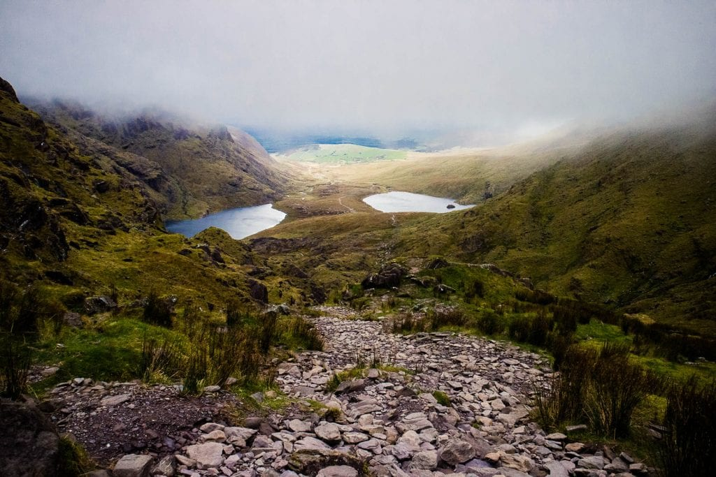 This is a hiking guide about how to climb Carrauntoohil, the highest mountain in Ireland, with different hiking trails up Carrauntoohil and what to pack!
