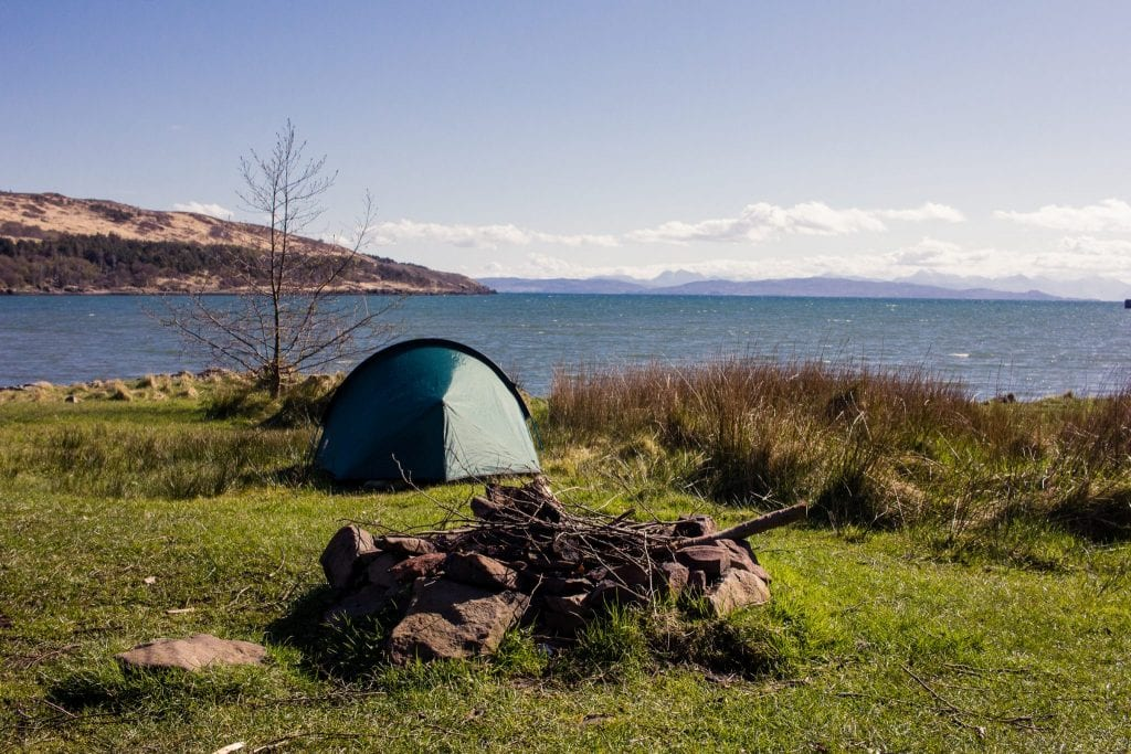 This photo shows a tent pitched by the waterfront at Kinloch Village Campsite on the Isle of Rum.