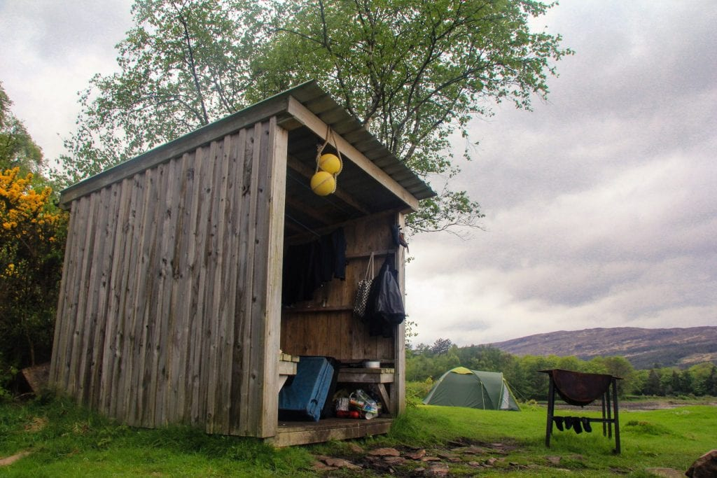 This photo shows the wooden shelter at Kinloch Village Campsite on the Isle of Rum.