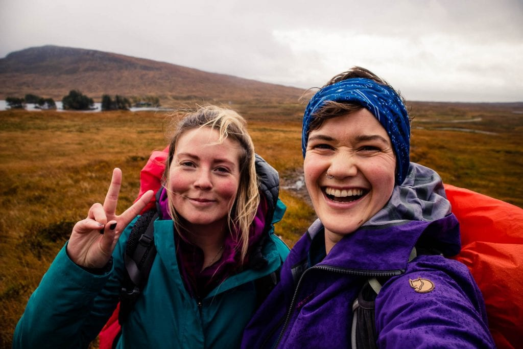 Two women in hiking clothes smiling at the camera near Loch Ossian Youth Hostel