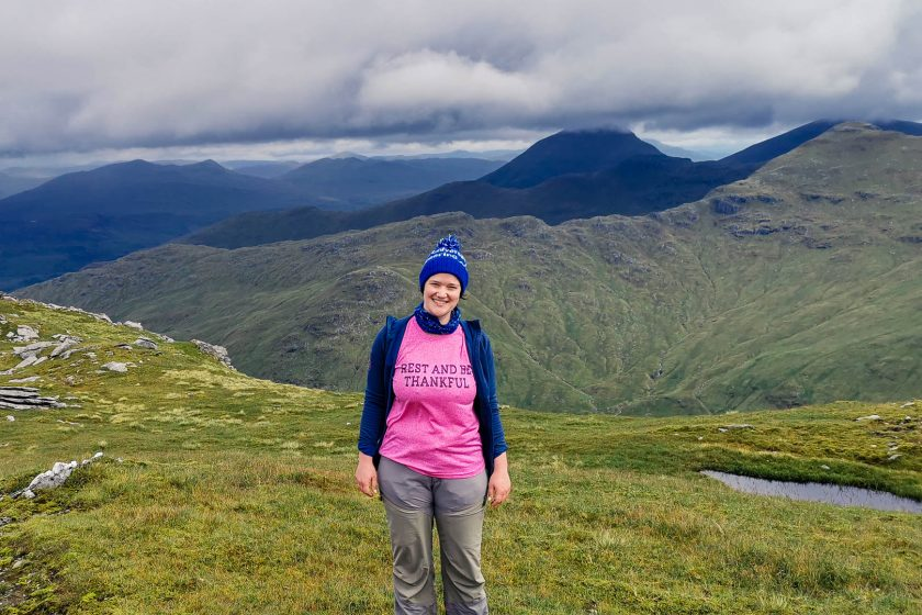 A woman standing in the Scottish Highlands