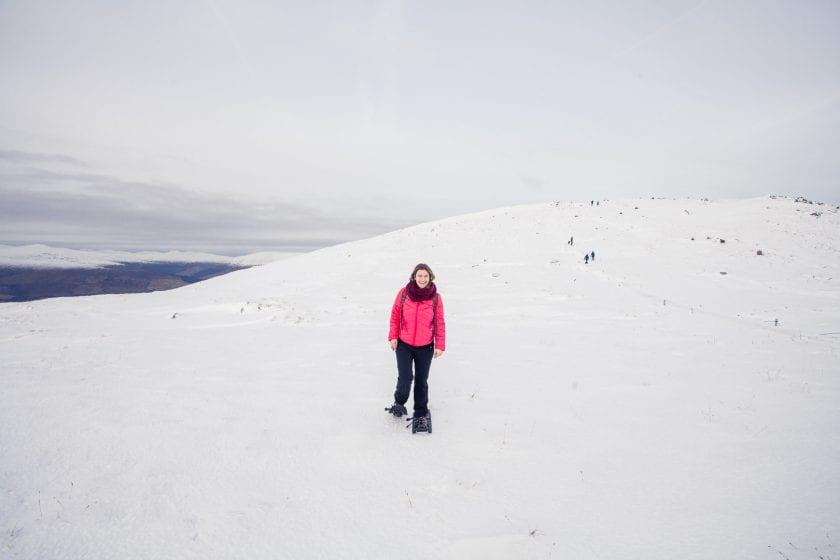 Girl snowshoeing in Scotland