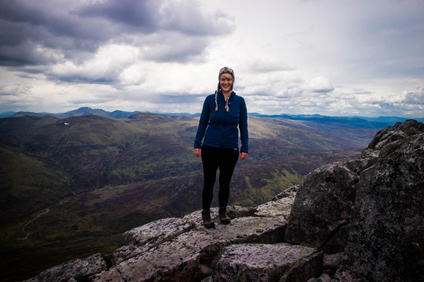 A woman in hiking on Schiehallion mountain in Scotland