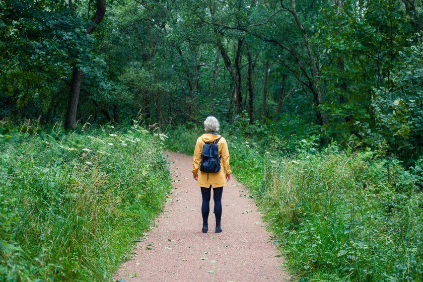A woman hiking at Seven Lochs Wetland Park, Glasgow, Scotland