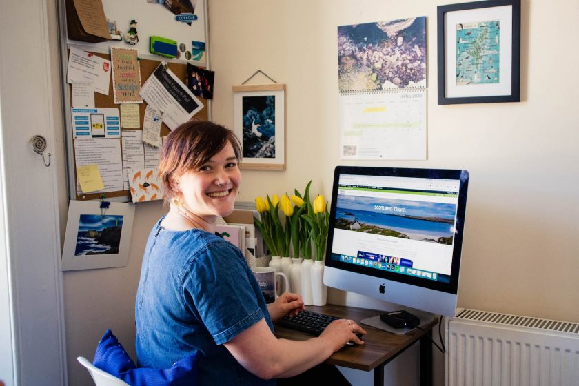 Travel blogger Kathi Kamleitner in her Glasgow home office, travel blogging during Corona.