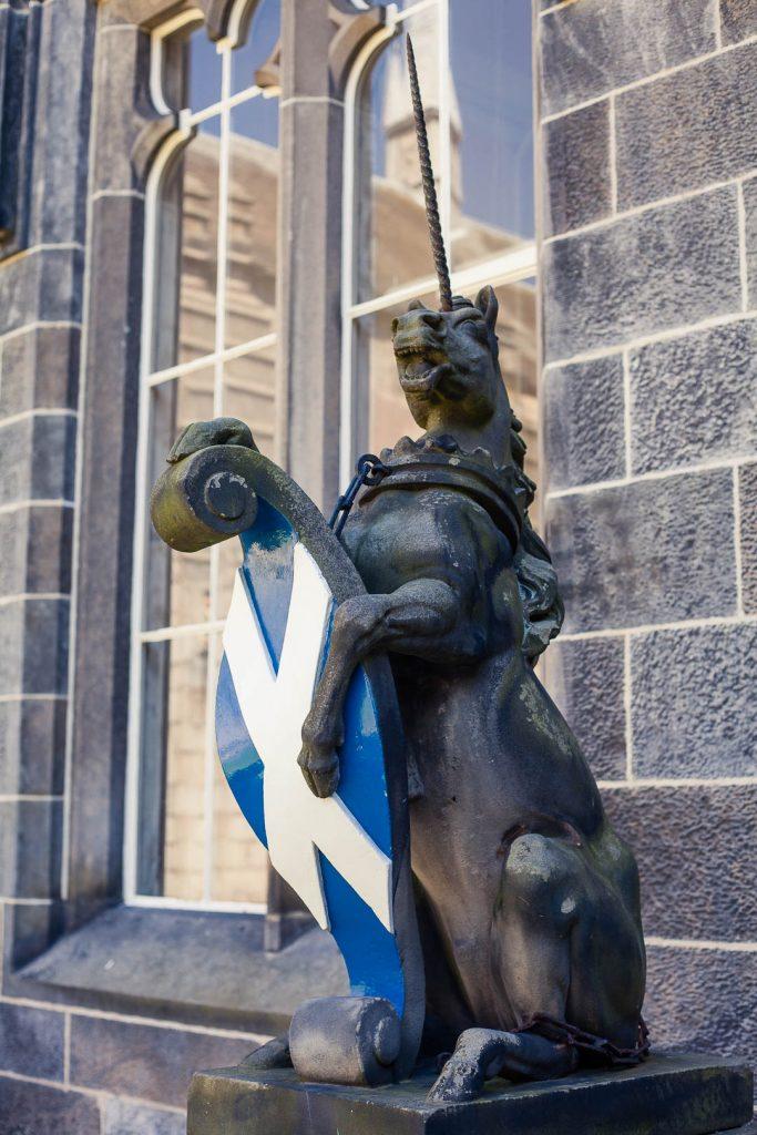 Status of a unicorn holding a Scotland flag