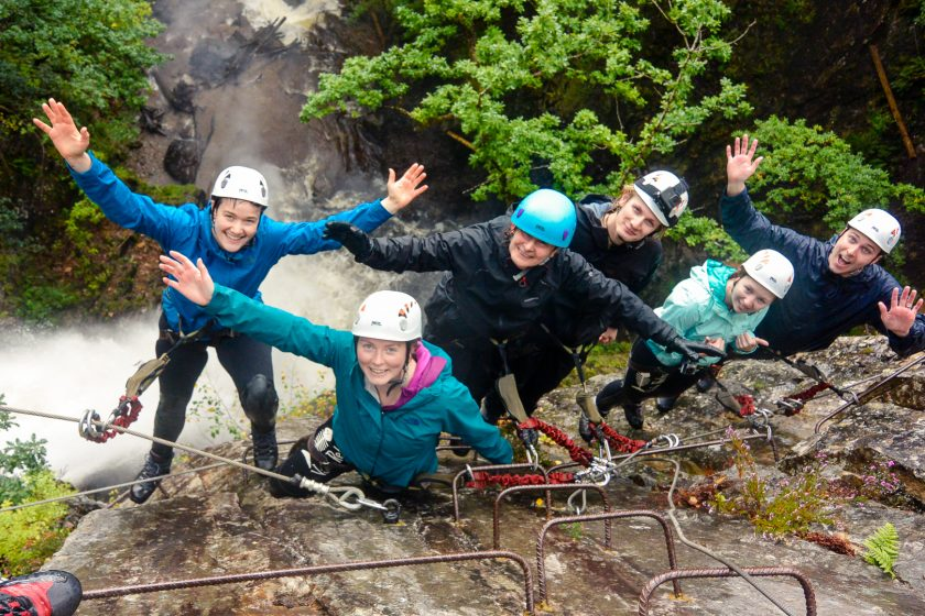 Hands-free group photo of climbers on the Via Ferrata Scotland