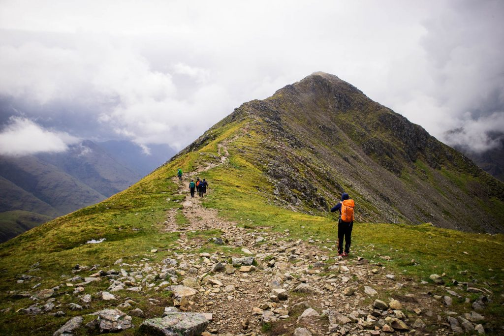 Women hiking to the summit of Buachaille Etive Beag, a Munro in Glencoe.