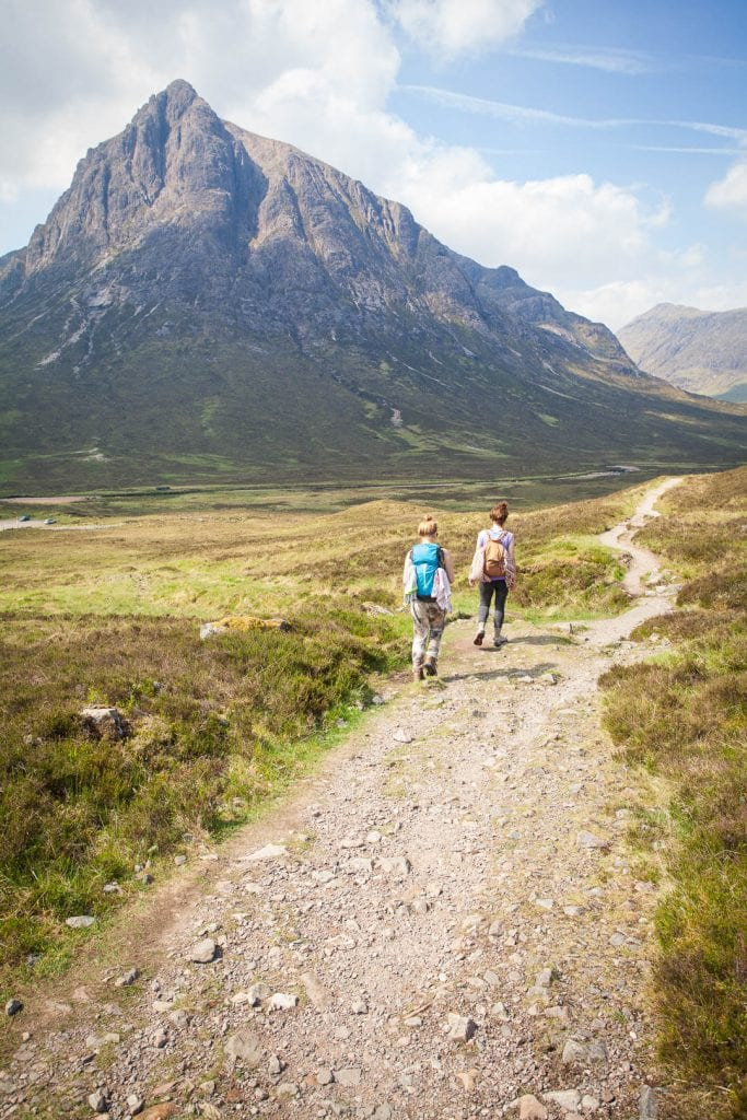 Two women hiking towards Buachaille Etive Mor in Scotland