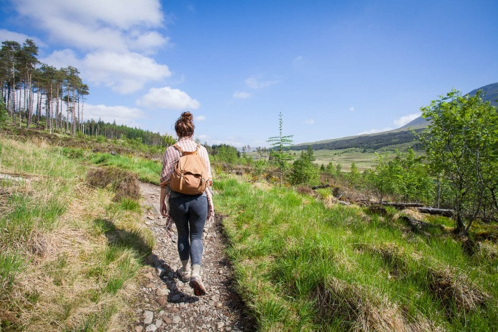 A woman walking the West Highland Way.
