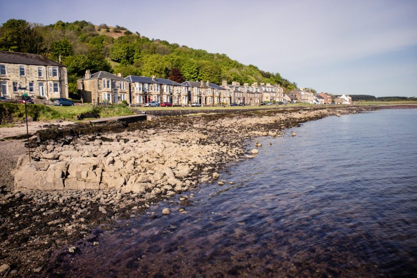 The scenic village of Kilchattan Bay on the Isle of Bute in Scotland