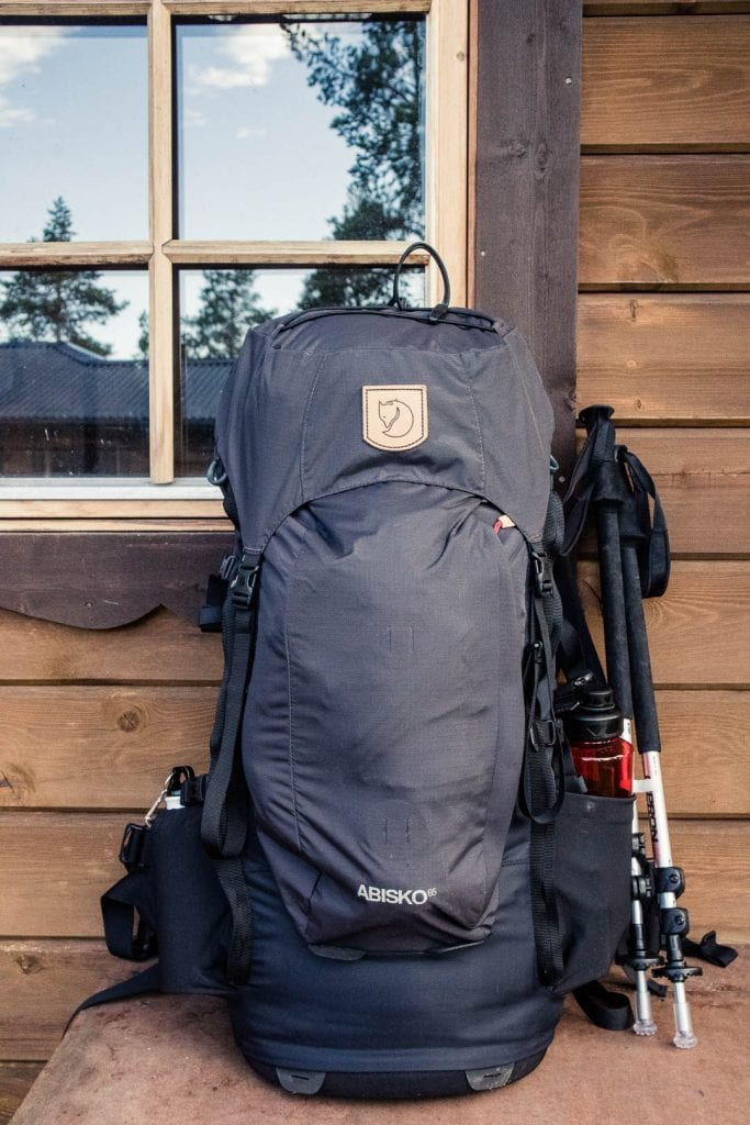 The Fjallraven Abisko 65 L backpack on a bench in Sweden - The best trekking backpacks & their must-have features