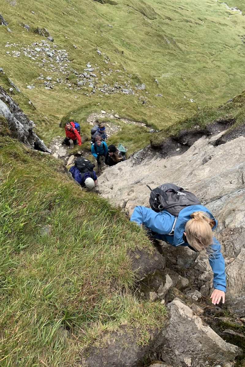 Scrambling up a mountain in Scotland